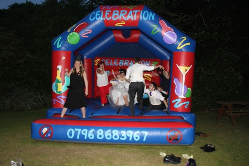 The Bride on the bouncy castle!
